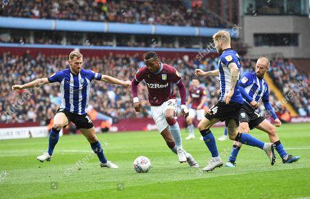 Jonathan Kodjia of Aston Villa beats Tom Lees, Ashley Baker and Barry Bannan of Sheffield Wednesday