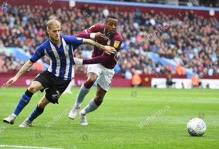 Ashley Baker of Sheffield Wednesday and Jonathan Kodjia of Aston Villa