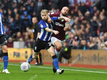 Alan Hutton of Aston Villa is fouled by Ashley Baker of Sheffield Wednesday