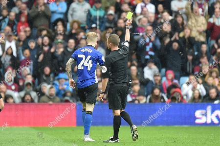 Sheffield Wednesday defender Ashley Baker (24) shown a yellow card,booked during the EFL Sky Bet Championship match between Aston Villa and Sheffield Wednesday at Villa Park, Birmingham