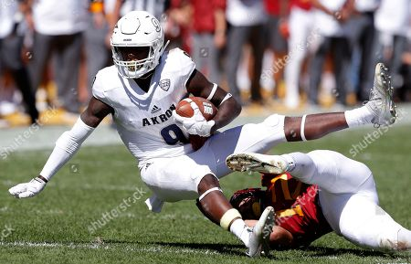 Andre Williams, Greg Eisworth. Akron wide receiver Andre Williams is tackled by Iowa State defensive back Greg Eisworth, right, after making a reception during the second half of an NCAA college football game, in Ames, Iowa. Iowa State won 26-13
