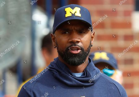 Former Michigan football player and Heisman Trophy winner Charles Woodson watches in the first half of an NCAA football game against Nebraska in Ann Arbor, Mich