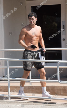 Spencer Boldman is spotted shirtless after a work out.