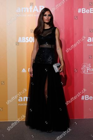 Model Bianca Balti poses for photographers upon arrival at the amfAR charity dinner during fashion week in Milan, Italy