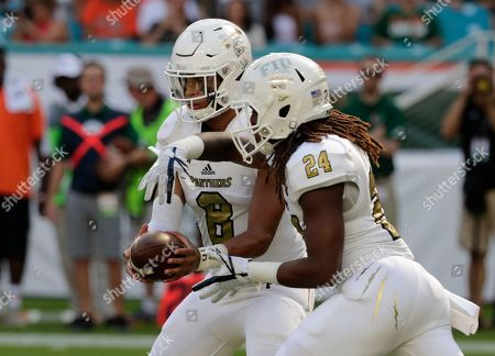 Christian Alexander, D'Vonte Price. FIU quarterback Christian Alexander (8) hands off the ball to running back D'Vonte Price (24) during the first half of an NCAA college football game against Miami, in Miami Gardens, Fla
