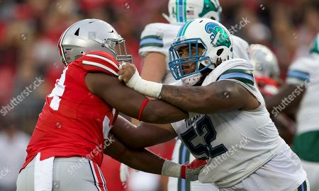Ohio State Buckeyes defensive end Tyler Friday (54) and Tulane Green Wave offensive lineman Dominique Briggs (52) at the NCAA football game between the Tulane Green Wave & Ohio State Buckeyes at Ohio Stadium in Columbus, Ohio