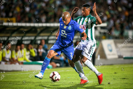 Vitoria de Setubal's Hildeberto Pereira vies for the ball with FC Porto's Maxi Pereira (L) during the Portuguese First League match between Vitoria Setubal and FC Porto, at Bonfim Stadium, in Setubal, Portugal, 22 September 2018.