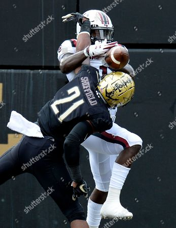Vanderbilt cornerback Donovan Sheffield (21) breaks up a pass intended for South Carolina wide receiver Deebo Samuel (1) during the first half of an NCAA college football game, in Nashville, Tenn