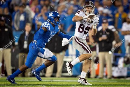 Mississippi State wide receiver Austin Williams (85) catches a pass and is tackled by Kentucky safety Davonte Robinson (9) during the second half of an NCAA college football game in Lexington, Ky