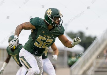Baylor Bears defensive end Greg Roberts (52) attempts to rush the pass blocking during the 2nd half of the NCAA Football game between the Kansas Jayhawks and the Baylor Bears at McLane Stadium in Waco, Texas