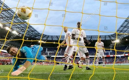 Toronto FC goalkeeper Alex Bono, left, dives but is unable to stop a scoring shot by New York Red Bulls midfielder Alejandro Romero Gamarra, not pictured, during the second half of a soccer game, in Harrison, N.J. The Red Bulls won 2-0