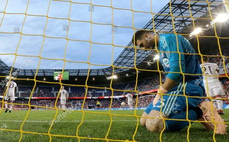 Toronto FC goalkeeper Alex Bono kneels in his goal after allowing a goal to New York Red Bulls midfielder Alejandro Romero Gamarra during the second half of a soccer game, in Harrison, N.J. The Red Bulls won 2-0