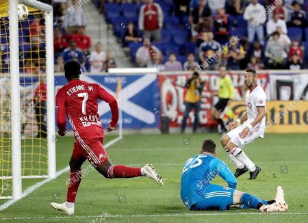 Toronto FC midfielder Victor Vazquez (7) watches as his shot enters the net of Toronto FC goalkeeper Alex Bono, bottom, as Toronto FC defender Justin Morrow, right, looks on during the second half of a soccer game, in Harrison, N.J. The Red Bulls won 2-0