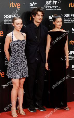 French director Louis Garrel (C) poses with French actresses Lily-Rose Melody Depp (L) and Laetitia Casta (R) during the presentation of the film 'L'Homme Fidèle' at the San Sebastian's Cinema International Festival in San Sebastian, Basque Country, Spain, 22 September 2018.