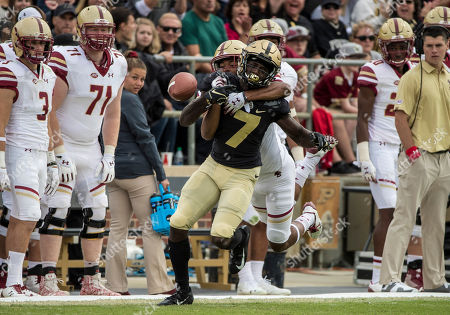 Boston College defensive back Brandon Sebastian (10) causes fumble by Purdue wide receiver Isaac Zico (7) during NCAA football game action between the Boston College Eagles and the Purdue Boilermakers at Ross-Ade Stadium in West Lafayette, Indiana. Purdue defeated Boston College 30-13