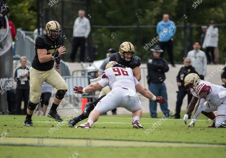 Boston College defensive lineman Ray Smith (96) makes the tackle on Purdue tight end Brycen Hopkins (89) during NCAA football game action between the Boston College Eagles and the Purdue Boilermakers at Ross-Ade Stadium in West Lafayette, Indiana. Purdue defeated Boston College 30-13