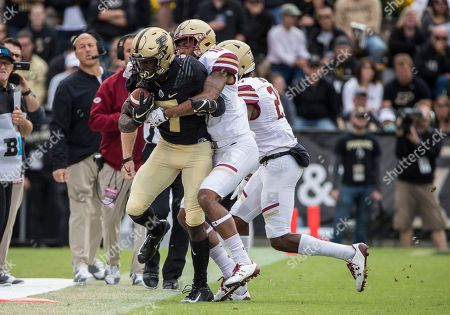 Purdue wide receiver Isaac Zico (7) fights for extra yardage as Boston College defensive back Brandon Sebastian (10) makes the tackle during NCAA football game action between the Boston College Eagles and the Purdue Boilermakers at Ross-Ade Stadium in West Lafayette, Indiana. Purdue defeated Boston College 30-13