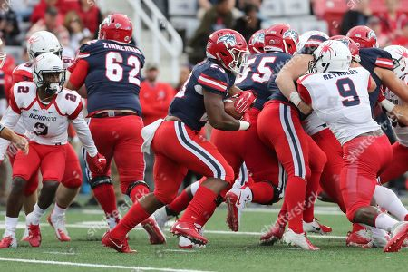 Stony Brook's Jordan Gowins #23 rushes against Richmond during an NCAA college football game on in Stony Brook, NY. Stony Brook won the game