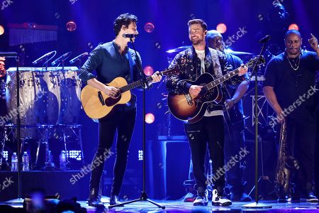 Shawn Mendes, Justin Timberlake. Shawn Mendes, left, and Justin Timberlake performs at the 2018 iHeartRadio Music Festival Day 2 held at T-Mobile Arena, in Las Vegas