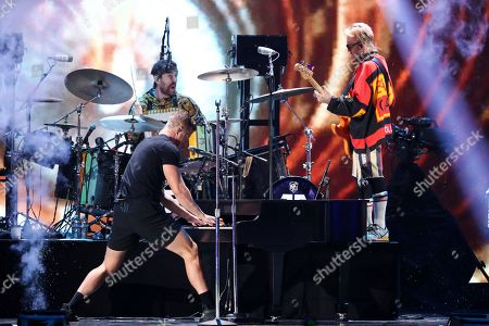 Dan Reynolds, Ben McKee. Dan Reynolds, left, and Ben McKee of the band Imagine Dragons performs at the 2018 iHeartRadio Music Festival Day 2 held at T-Mobile Arena, in Las Vegas