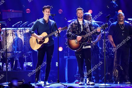 Shawn Mendes, Justin Timberlake. Shawn Mendes, left, and Justin Timberlake perform at the 2018 iHeartRadio Music Festival Day 2 held at T-Mobile Arena, in Las Vegas