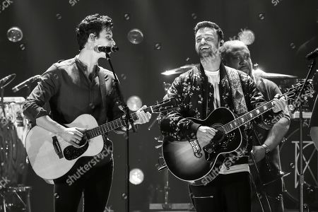 Stock Picture of Shawn Mendes, Justin Timberlake. Shawn Mendes, left, and Justin Timberlake performs at the 2018 iHeartRadio Music Festival Day 2 held at T-Mobile Arena, in Las Vegas