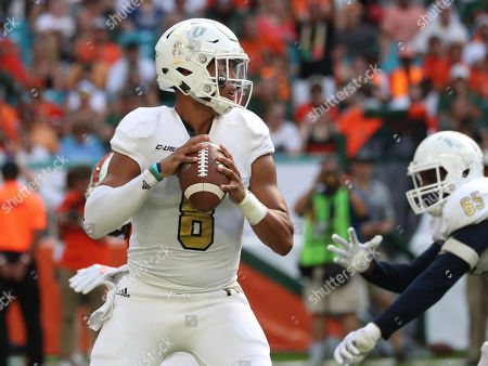 Stock Photo of FIU Panthers quarterback Christian Alexander (8) in action during the college football game between the FIU Panthers and the Miami Hurricanes at the Hard Rock Stadium in Miami Gardens, Florida. The Hurricanes won 31-17