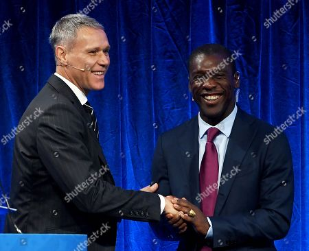 Former Dutch football players Clarence Seedorf (R) and Marco Van Basten (L) shake hands during the FIFA Football Conference in London, Britain, 23 September 2018. Coaches and technical directors from nearly 200 member associations and all six confederations will take part in discussions on coaching matters, lessons learnt from FIFA World Cup Russia 2018 and the use of video assistant referee (VARs), among others.