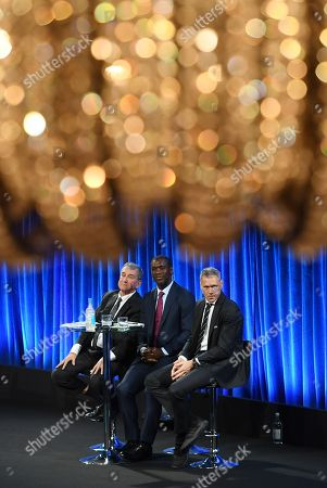 (L-R) Former Brazil's football manager, Carlos Alberto Parreira and former Dutch football players Clarence Seedorf and Marco Van Basten speak during the FIFA Football Conference in London, Britain, 23 September 2018. Coaches and technical directors from nearly 200 member associations and all six confederations will take part in discussions on coaching matters, lessons learnt from FIFA World Cup Russia 2018 and the use of video assistant referee (VARs), among others.