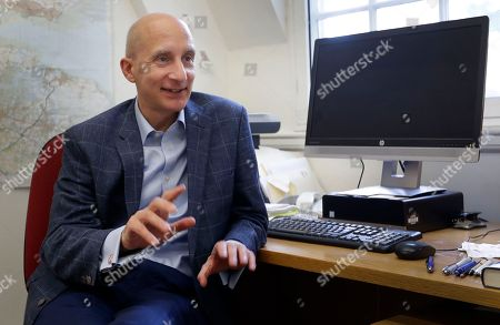 Labour member of the House of Lords, Andrew Adonis speaks during an interview with The Associated Press in London, . Adonis supports holding a second referendum on the Brexit issue, and says Labour can't sit on the sidelines while the country staggers toward political and financial chaos