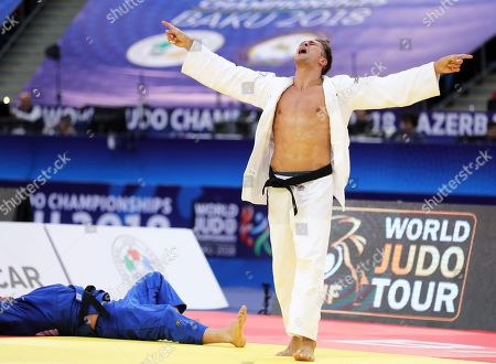 Alexander Wieczerzak (white) of Germany celebrates after beating his compatriot Dominic Ressel (blue) in their men's -81kg category bronze medal bout at the Judo World Championships 2018 in Baku, Azerbaijan, 23 September 2018.
