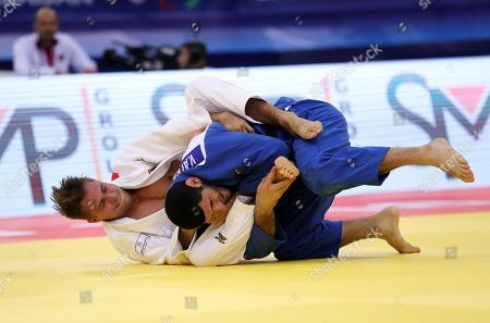 Vedat Albayrak of Turkey (blue) in action against Alexander Wieczerzak of Germany (white) during the men's -81kg category quarter final match at the Judo World Championships 2018 in Baku, Azerbaijan, 23 September 2018.
