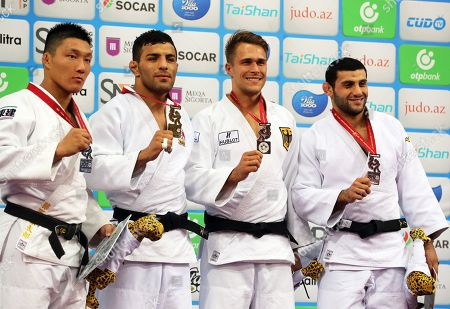 Saeid Mollaei (2-L) of Iran poses with his gold medal on the podium after winning the men's -81kg category final at the Judo World Championships 2018 in Baku, Azerbaijan, 23 September 2018. Mollaei won ahead of second placed Sotaro Fujiwara (L) of Japan and third placed Alexander Wieczerzak (2-R) of Germany and Vedat Albayrak (R) of Turkey, both sharing the bronze medal.