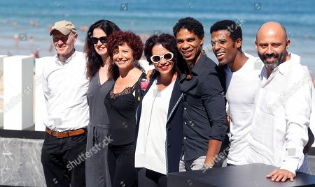 Spanish director Iciar Bollain (3L) poses with actors and cast members Laura de la Uz (C), Carlos Acosta (3R) and Keyvin Martínez (2R), scriptwriter Paul Laverty (L) and producers Juan Gordon (R) and Andrea Calderwood during the presentation of her film 'Yuli' at the 66th edition of San Sebastian international Film Festival (SSIFF), in San Sebastian, Basque Country, northern Spain, 23 September 2018. The SSIFF will be held from 21 to 29 September 2018.