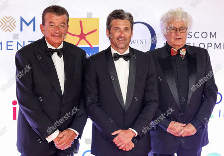 Stock Photo of US actor Patrick Dempsey (C) poses for a photo with Tunisians film producer and distributor Tarak Ben Ammar (L) and French director and screenwriter Jean-Jacques Annaud (R) during a reception for Gouna Film Festival at El Gouna, 470km southeast of Cairo, Egypt, 22 September 2018 (Issued 23 September 2018). The second edition of El Gouna Film Festival is held between 20 to 28 September 2018 at the red sea city of El Gouna, 470km southeast of Cairo.