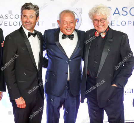 Egyptian Businessman Naguib Sawiris (C) poses for a photo with US actor Patrick Dempsey (L) and French director and screenwriter Jean-Jacques Annaud (R) during a reception for Gouna Film Festival at El Gouna, 470km southeast of Cairo, Egypt, 22 September 2018 (Issued 23 September 2018). The second edition of El Gouna Film Festival is held between 20 to 28 September 2018 at the red sea city of El Gouna, 470km southeast of Cairo.