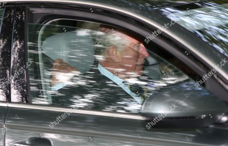 Prince Charles adjusts his seat belt whilst driving to Crathie Church