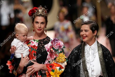 Isabella Rossellini, Elettra Rossellini. Model Elettra Rossellini Wiedemann, left, poses with her mother actress Isabella Rossellini as they wear creations as part of the Dolce & Gabbana women's 2019 Spring-Summer collection, unveiled during the Fashion Week in Milan, Italy