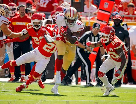 San Francisco 49ers running back Alfred Morris (46) is tackled by Kansas City Chiefs defensive back Eric Murray (21) and defensive back Steven Nelson (20) during the first half of an NFL football game in Kansas City, Mo