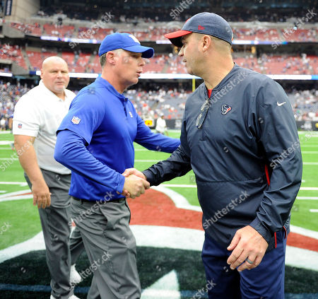 New York Giants coach Pat Shurmur, left, shakes hands with Houston Texans coach Bill O'Brien after an NFL football game, in Houston. The Giants won 27-22