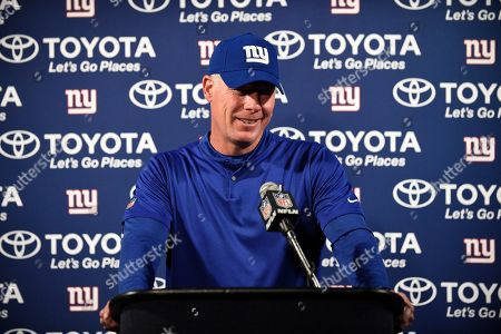 New York Giants coach Pat Shurmur answers a question during a news conference after an NFL football game against the Houston Texans, in Houston. The Giants won 27-22