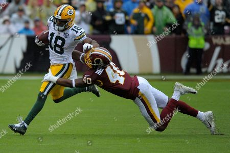 Stock Photo of Green Bay Packers wide receiver Randall Cobb (left) runs the ball against Washington Redskins linebacker Josh Harvey-Clemons (right) during an NFL football game between the Green Bay Packers and Washington Redskins, in Landover, Md