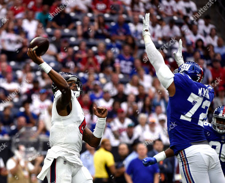 Houston Texans quarterback Deshaun Watson (4) throws a pass as New York Giants defensive end Kerry Wynn (72) defends during the first half of an NFL football game, in Houston