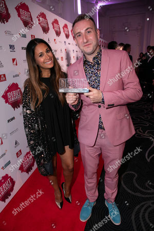 Gus Gowland accepts the award, presented by Preeya Kalidas, for Best Composer or Lyricist