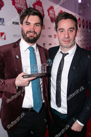 Andrew Thompson accepts the award, presented by James Graham, for Best Writer