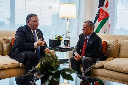 Secretary of State Mike Pompeo, left, talks to Jordan's King Abdullah II bin Al-Hussein, right, during a meeting at Mandarin Oriental Hotel, in New York