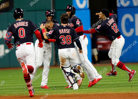 Greg Allen, Erik Gonzalez, Eric Haase, Yandy Diaz, Francisco Lindor. Cleveland Indians' Greg Allen, center, is mobbed by teammates Erik Gonzalez, Eric Haase (38), Yandy Diaz and Francisco Lindor as they celebrate his game winning single in the eleventh inning of a baseball game against the Boston Red Sox, in Cleveland. Cleveland won 4-3