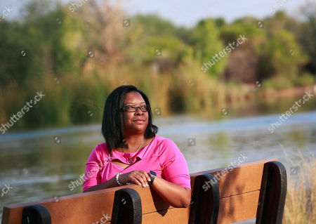 Yvonne Ambrose, mother of murder victim Desiree Robinson, sits at the Riparian Preserve in Gilbert, Ariz. Ambrose's 16-year-old daughter was trafficked in Chicago on Backpage.com and was killed by a buyer on Christmas Eve 2016. Ambrose joined President Donald Trump at the White House when he signed the legislation, the Allow States and Victims to Fight Online Sex Trafficking Act
