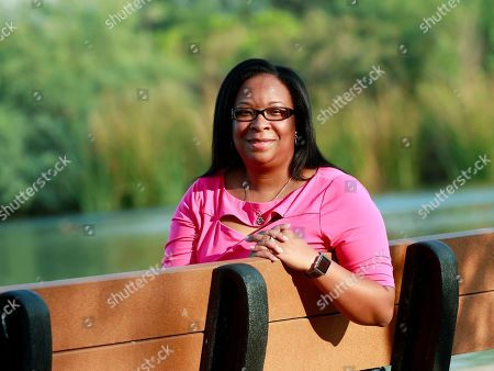 Stock Photo of Yvonne Ambrose, mother of murder victim Desiree Robinson, poses for a photo at the Riparian Preserve in Gilbert, Ariz. Ambrose's 16-year-old daughter was trafficked in Chicago on Backpage.com and was killed by a buyer on Christmas Eve 2016. Ambrose joined President Donald Trump at the White House when he signed the legislation, the Allow States and Victims to Fight Online Sex Trafficking Act