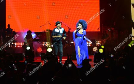 Descemer Bueno and Aymee Nuviola performs on stage
